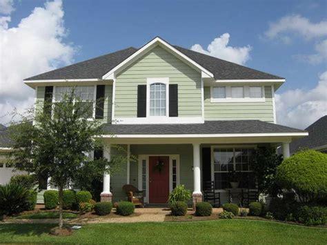 green house black shutters white trim white posts