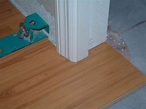 How to lay laminate flooring through a doorway blog for How to lay laminate flooring through a doorway