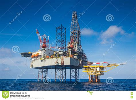 Work Over Rig, Pumpjack, And A Drilling Rig Royalty-free