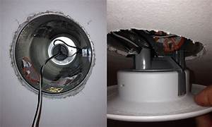 Recessed light hole saw page top holes cut out and wires