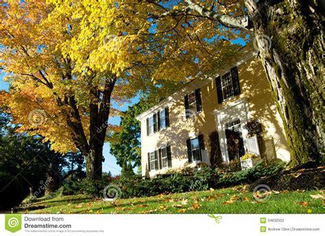 england colonial  autumn  maples stock photo