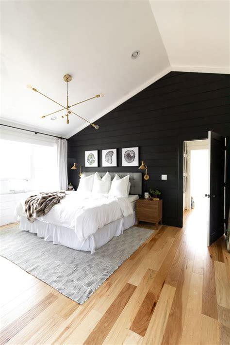 black  white modern master bedroom bright green door