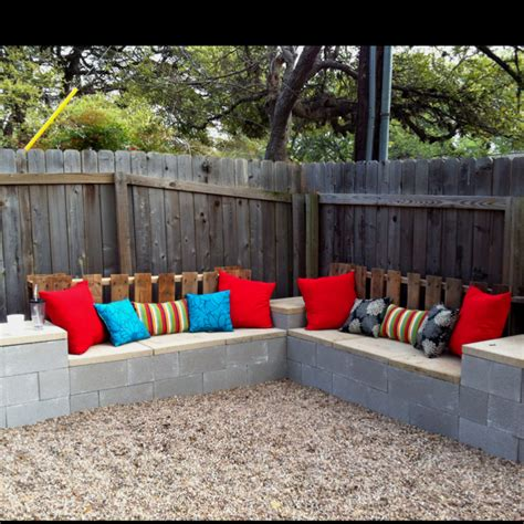 cinder block furniture backyard cement block bench stucco with some pillows on top it