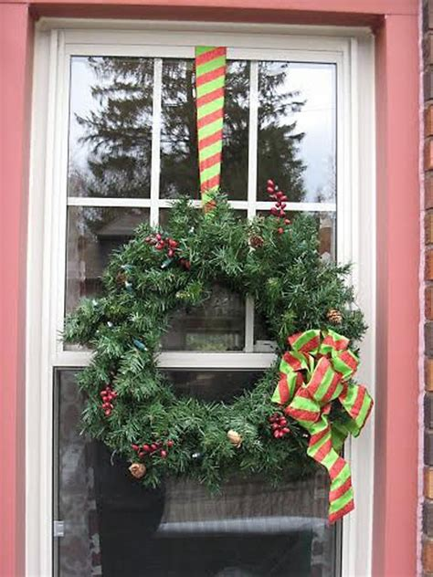lighted clear swags  red bow outdoor christmas window
