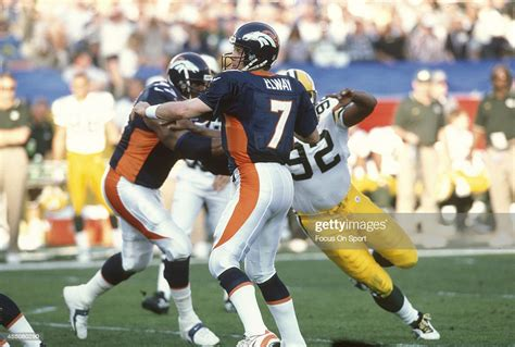 John Elway Of The Denver Broncos Looks To Throw A Pass