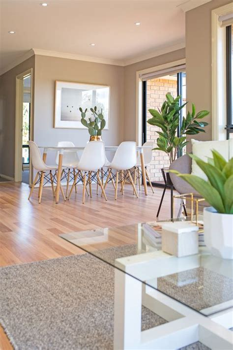 This kitchen and living room styled by alison lewis is united by a large opening in the wall, but is separated by design. Open plan kitchen, dining and living room, small living, grey wool knotted floor rug, neut ...