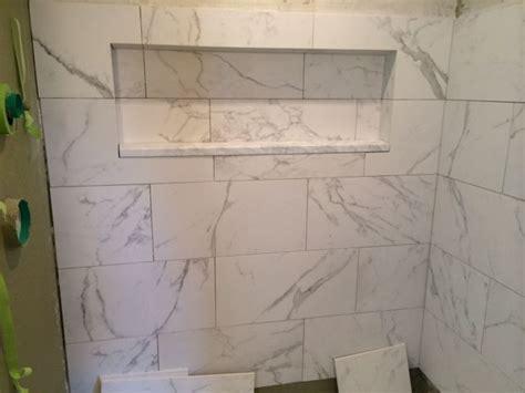 faux carraras marble tile  water closet pinterest
