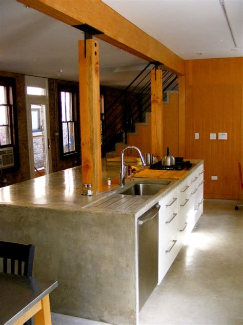 wood concrete kitchen island stair door  architects