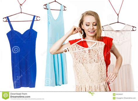 woman  shop  wardrobe picking dress stock image