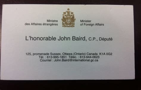 John Baird's 'english Only' Business Cards Violated