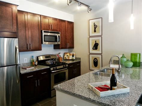 pull kitchen faucets stainless steel bozzuto community resident enthusiastic about moving into