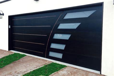Contemporary_wood_glass_garage_door_san_diego_by_radford