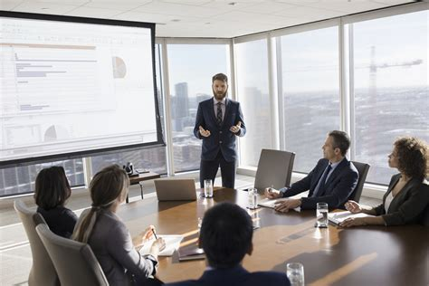 businessman leading   projection screen