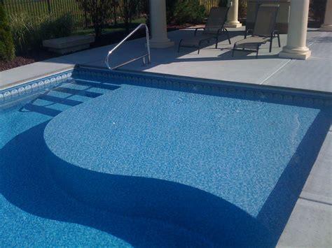 tanning ledge   pool designed  built  caribbean