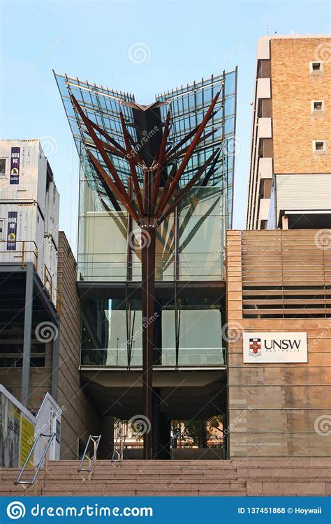 modern  shaped glass canopy  brown timber column