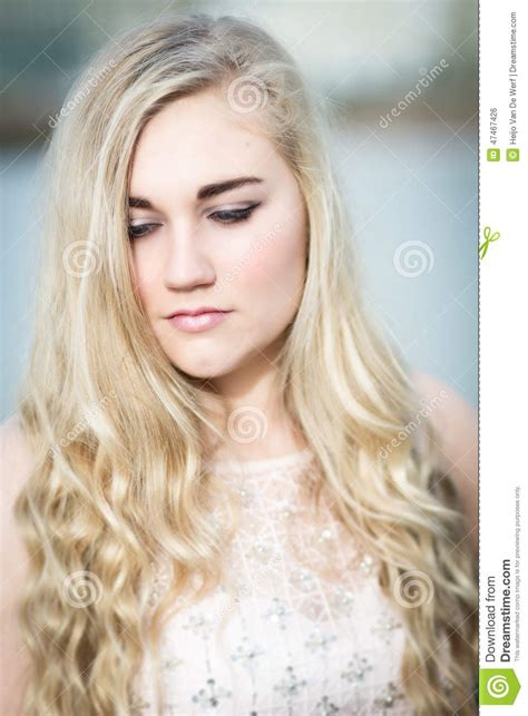 Beautiful Blond Teenage Girl With Blue Eyes Stock Photo