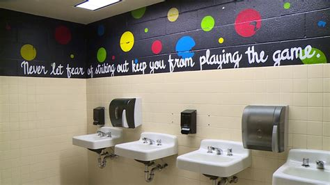 Parent Paints Messages On School Bathroom Walls To Inspire Students