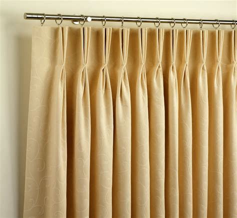 pinch pleated curtains with rods and rings window