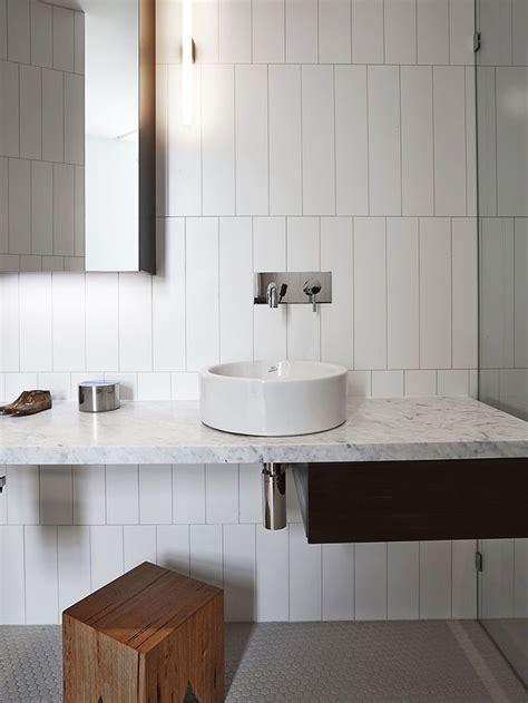 Rectangular white ceramic bathroom tile, staggered