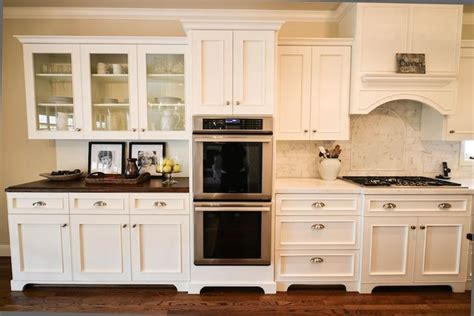 wall of cabinets with double ovens; stove & hutch/butler's