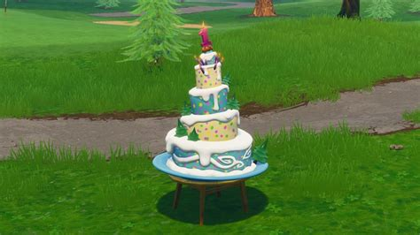 fortnite birthday cake fortnite birthday cake locations where to in front