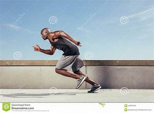 Action Shot Of A Sporty Young Man Running Outdoors Stock ...