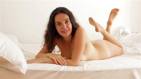 Beautiful Nude Girl Laying On Bed At Bedroom Stock Footage