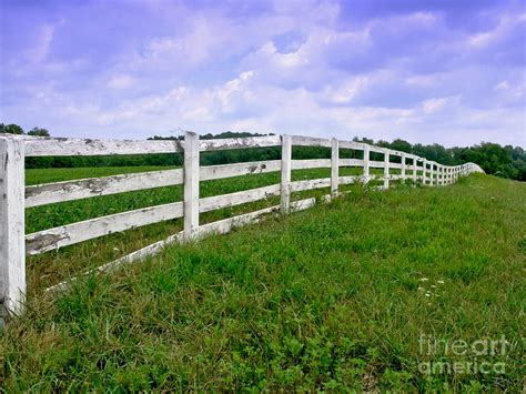 white wood fence photograph by olivier le queinec