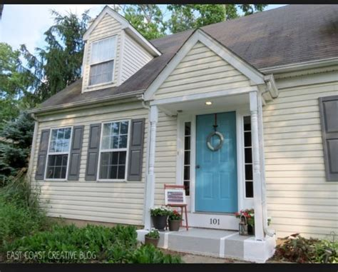 cream siding navy blue shutters google search house