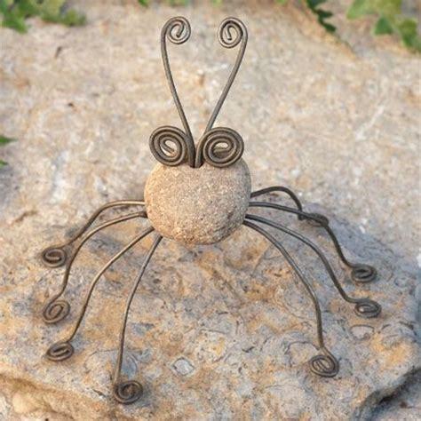river stone  wire garden spider  ancient graffiti