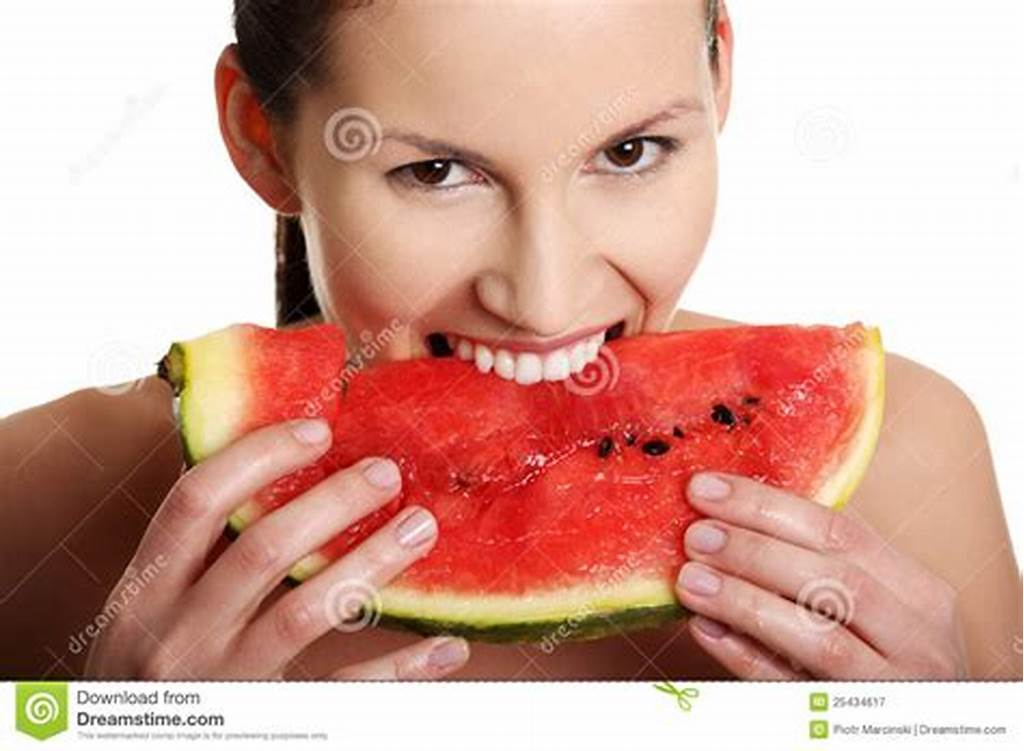 #Young #Beautiful #Woman #Is #Eating #Watermelon