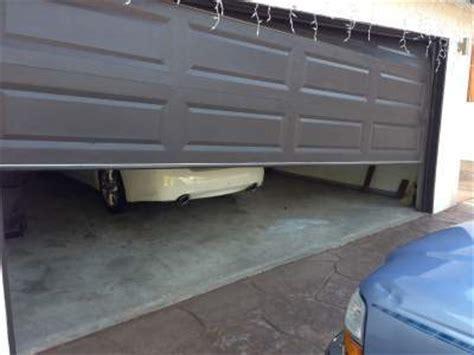 Offtrack Garage Doors Sacramento Ca  Call Now For Free Quote. Wooden Toy Garage. Garage Sink. Cheap Front Doors. Behind Door Storage. Horse Stall Door. Front Door Shoe Storage. Baldwin Door Lock. Best Paint For Garage Door