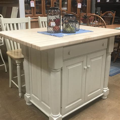 butcher block kitchen island featuring overhang  seating
