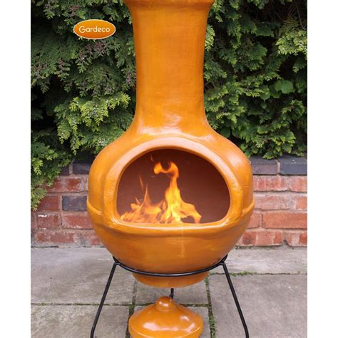 A fire pit is an open burning bowl, whereas a chiminea is built with a chimney. clay fire pit chiminea » Design and Ideas