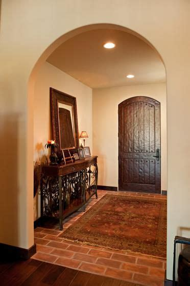 Mediterranean entryway, mediterranean foyer with warm