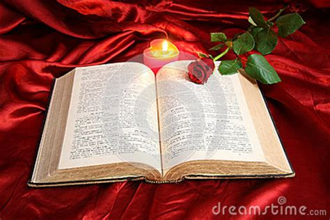 heart candle  open bible  red rose stock photo