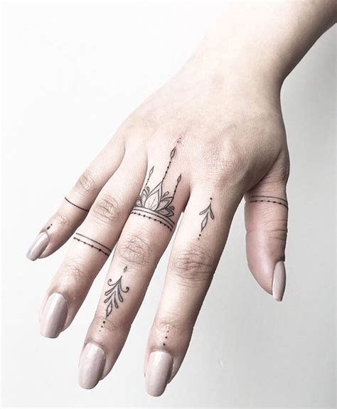 finger frau finger tattoos by joanna done at chronic ink
