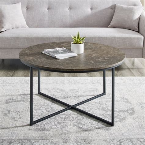 Marble look tops draw the eye with their muted shades of cream, onyx and gray and provide a durable yet beautiful surface for placing drinks and decorative accents. Brown & Black Faux Marble X-Base Coffee Table — Pier 1