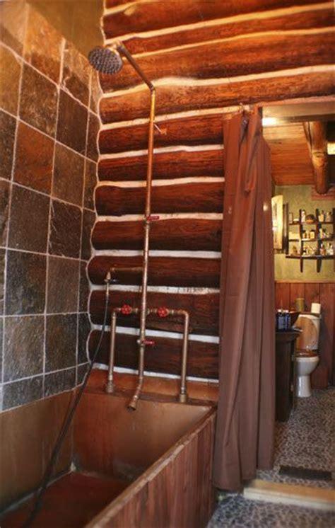 exposed homemade plumbing fixtures rustic bathrooms