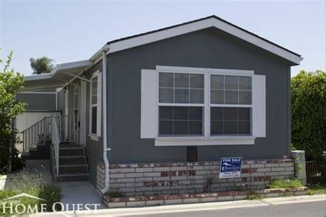 mobile home gray exterior color with white trims
