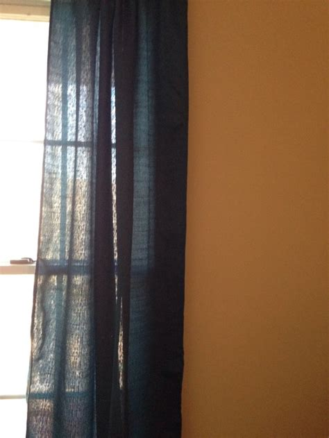 grey curtains with beige walls
