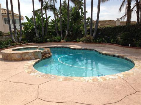 Stone Backyard Swimming Pool Remodel