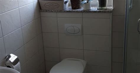 updating dated bathroom tiles with concrete hometalk