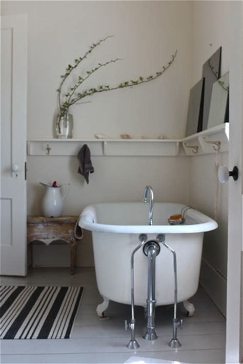 Use Shelf With Pegs As Chair Rail In The Bathroom With The