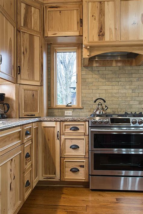 earthy tones   rustic hickory cabinets brown brick