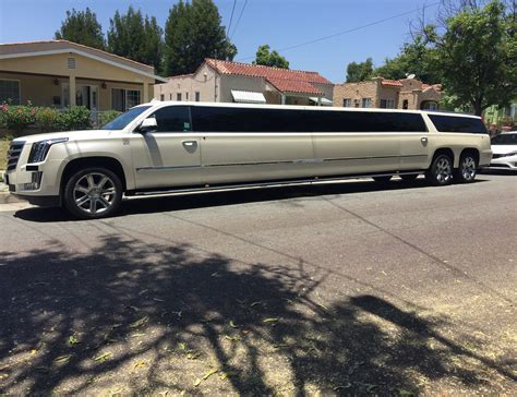 white double axle cadillac escalade stretch limousine