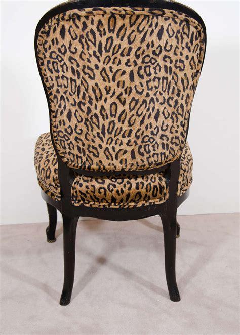 pair of antique ebonized slipper chairs with velvet