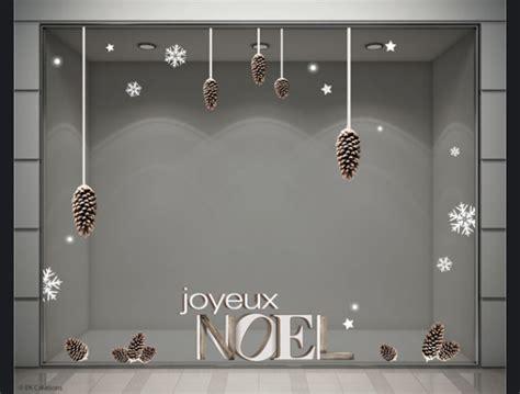 stickers decoration vitrine magasin noel pomme de pin flocon fete 600x455 jpg 600 215 455 id 233 es