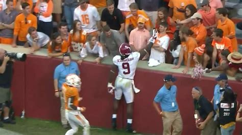 bama rb put  hand    tennessee fans face