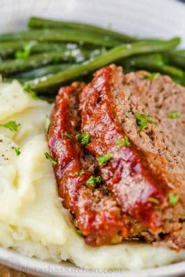 A meatloaf recipe for people who love their meatloaf oozing with flavour, moist and tender yet not crumble apart when sliced. Meatloaf Recipe with the Best Glaze - NatashasKitchen.com